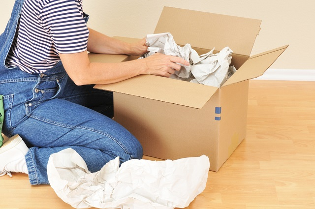 How do you assist in packing the household items?
